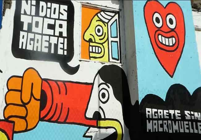 Pintura Colectiva realizada en la fachada de una vivienda abandonada en el #PaseoDeLosPoetas en el Paseo del #PuertoDeLasNieves Firma para paralizar la ampliación del Macromuelle de #Agaete